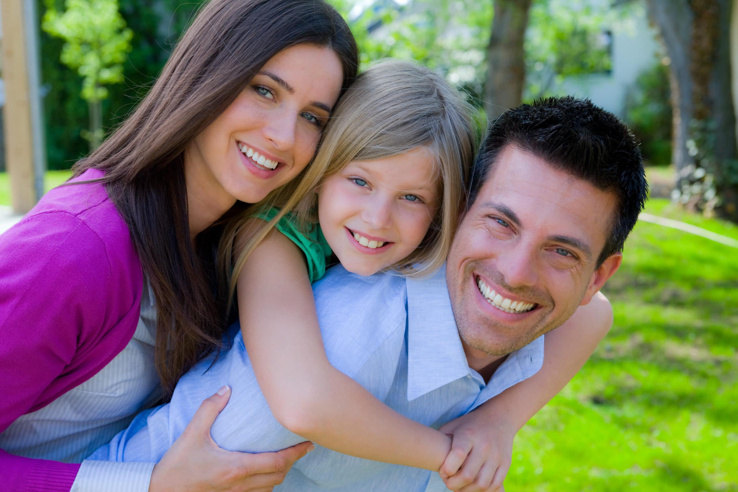 Brampton dentist - family smiling